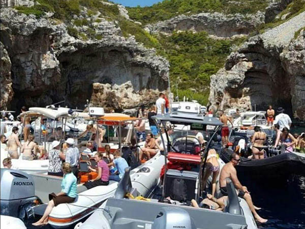 Stiniva beach on the Croatian island of Vis Crowded Reality